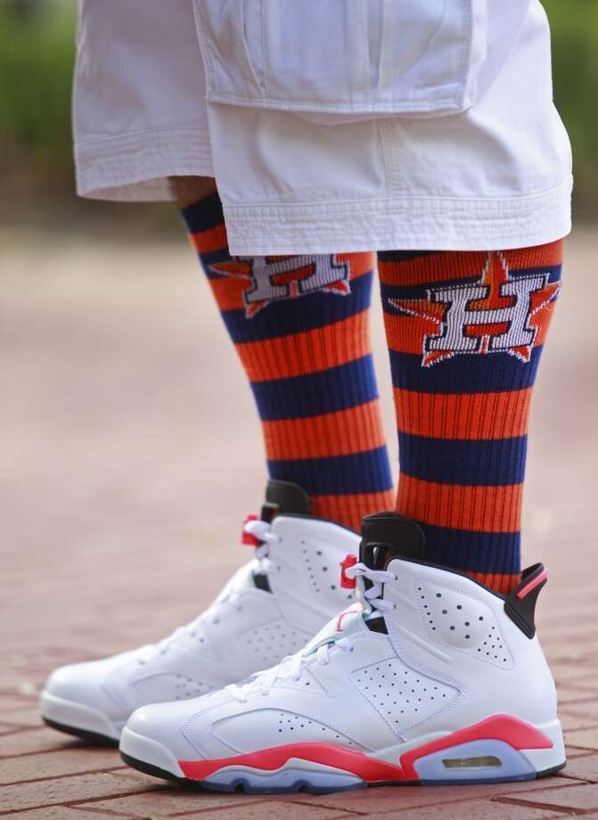 Cesar Rodela of Houston wears Astros socks as he attends the 13th Annual Street Festival. Photo: Melissa Phillip, Houston Chronicle