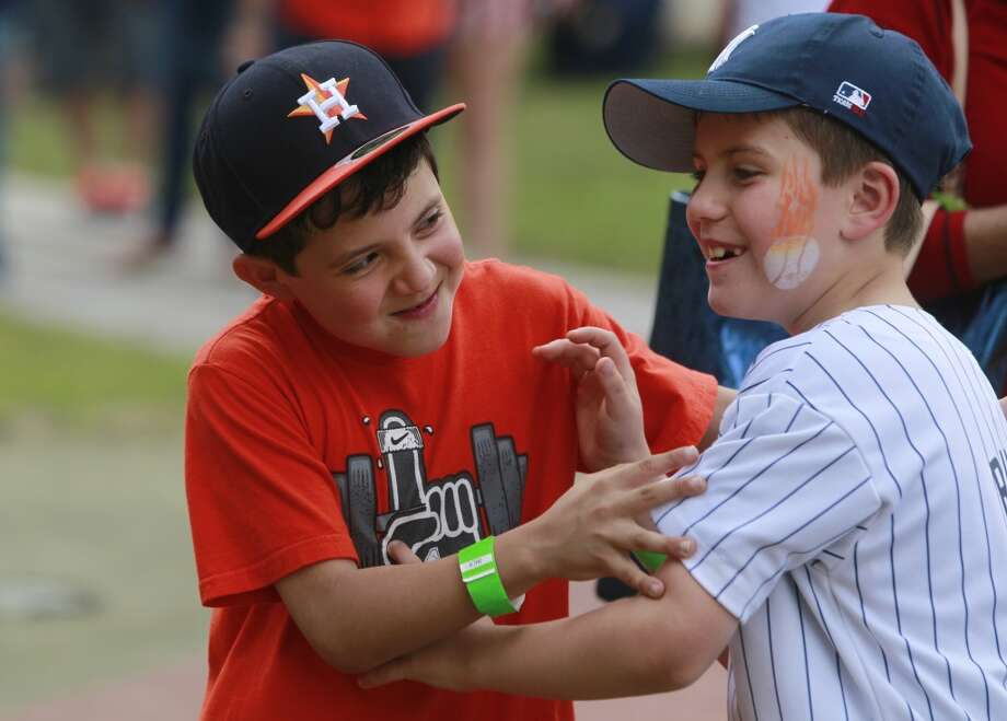 Astro fan Jeremy Maz, 8, left, and Yankees fan Thomas Guy, 8, right, both of Katy play together at the 13th Annual Street Festival. Photo: Melissa Phillip, Houston Chronicle
