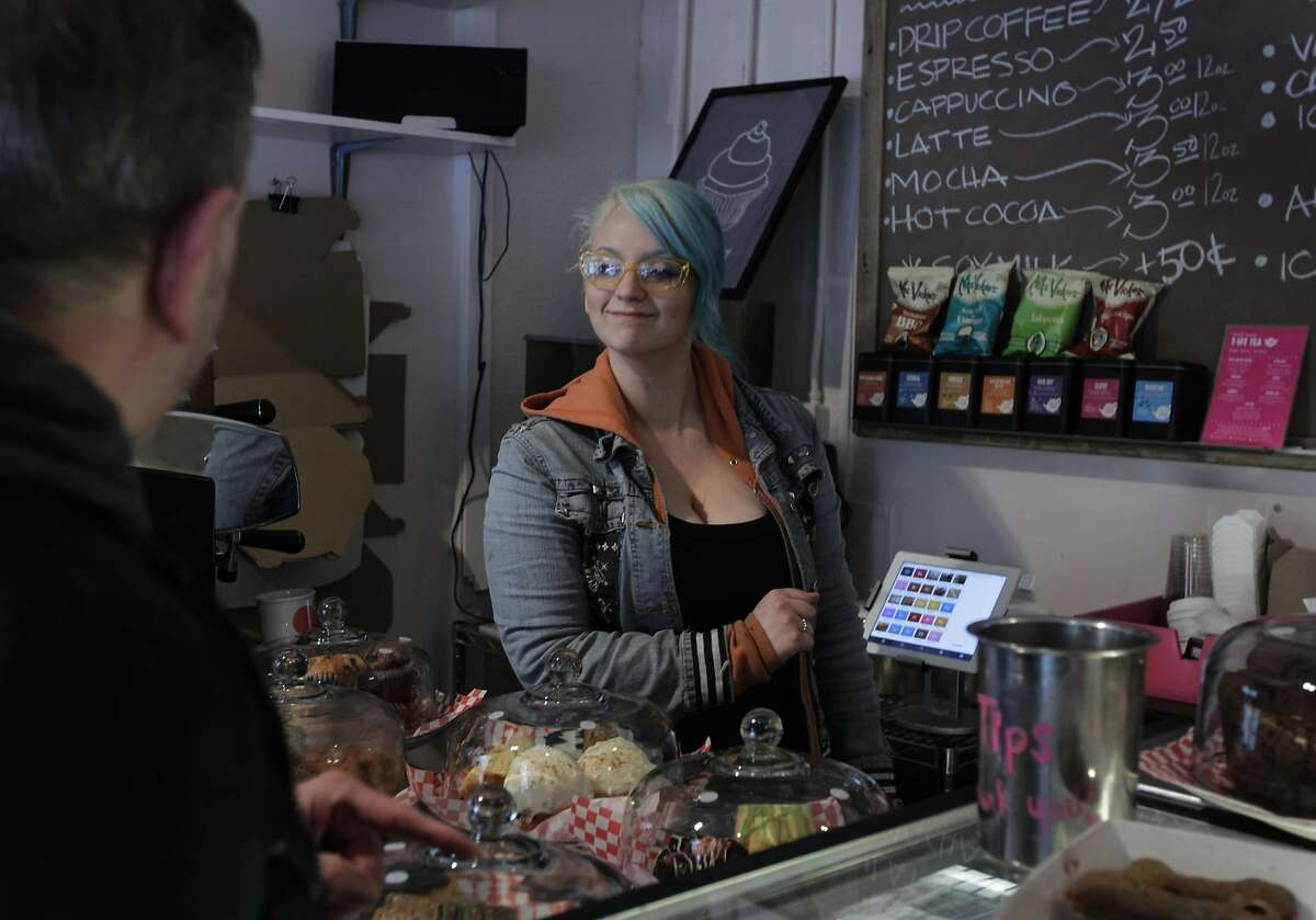 Danielle Jalilie helps customer Rob Lieber at Pinkie's Bakery in San Francisco. The store uses the data collected from the analytics provided by the Square payment system to streamline its business.