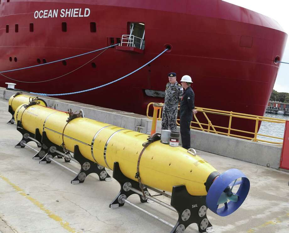 An autonomous underwater vehicle sits on the wharf at a naval base in Perth on Sunday, ready to be fitted to the Australian warship Ocean Shield to aid in the search for missing Malaysia Airlines Flight 370. The ship will also be equipped with a black-box detector. Photo: Bob Griffith / Associated Press / AP
