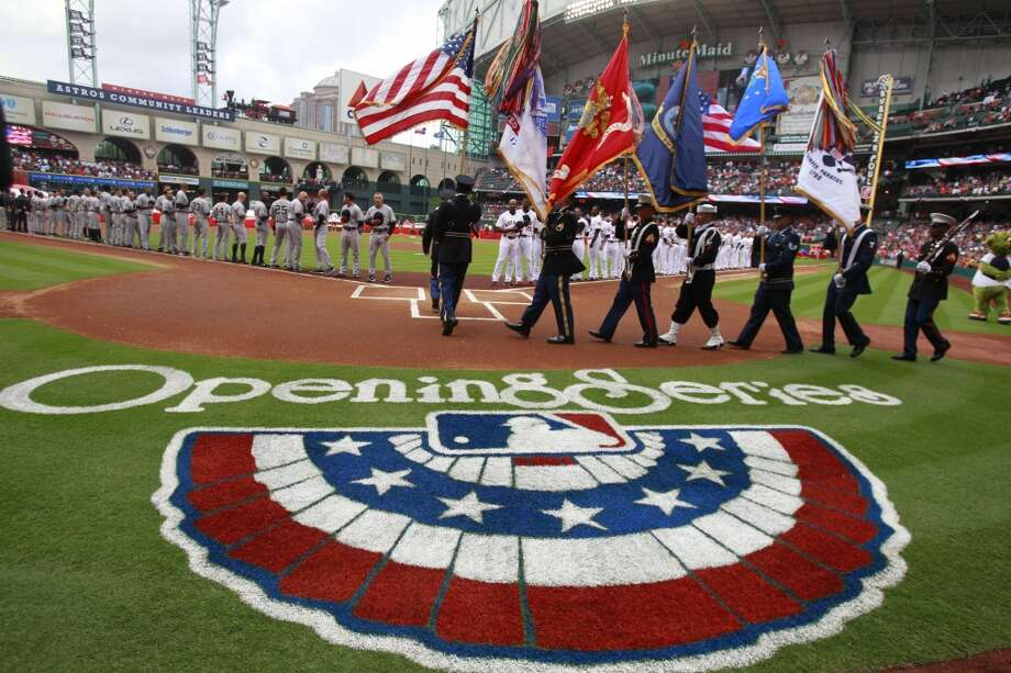 The flag is presented for Opening Day at Minute Maid Park. Photo: Melissa Phillip, Houston Chronicle