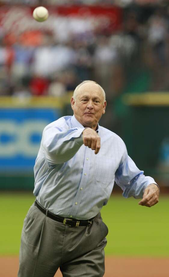 Nolan Ryan throws out the ceremonial first pitch to Craig Biggio. Photo: Melissa Phillip, Houston Chronicle