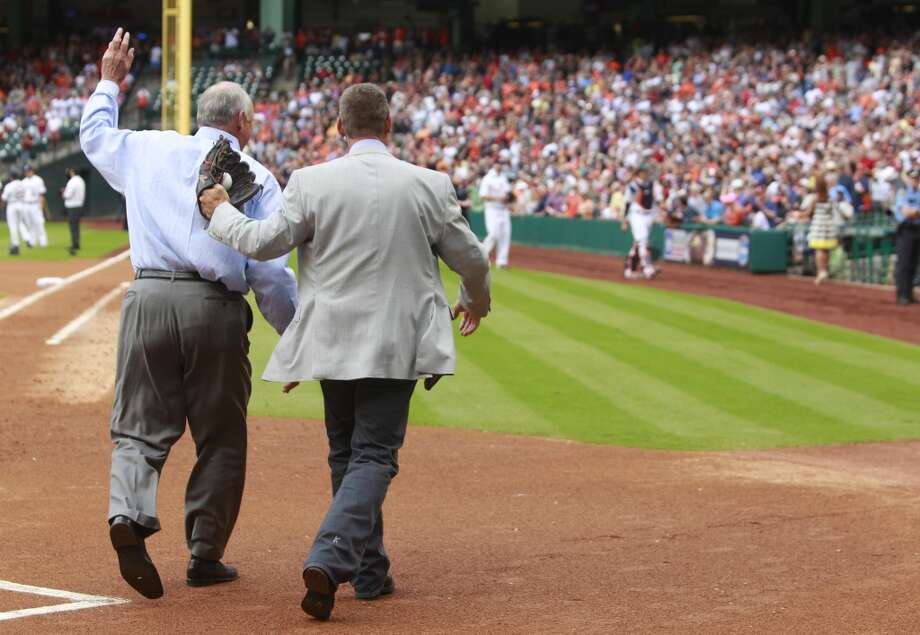 Craig Biggio and Nolan Ryan leave the field together after the ceremonial first pitch. Photo: Melissa Phillip, Houston Chronicle
