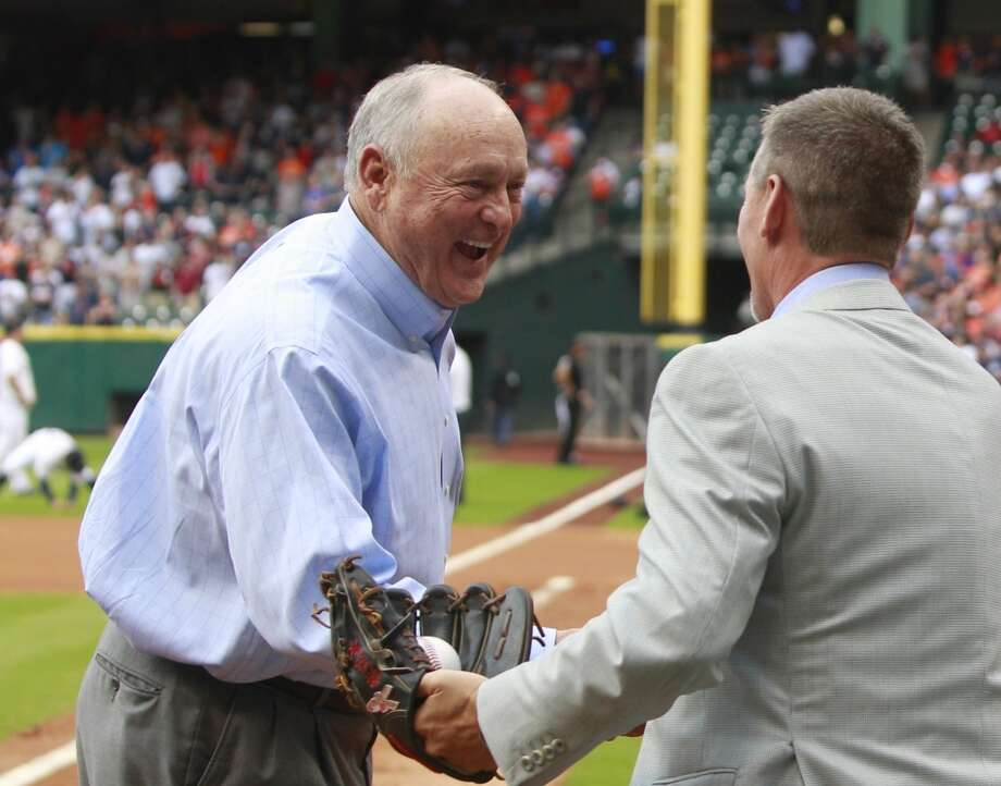 Nolan Ryan shakes hands with Craig Biggio after their first pitch. Photo: Melissa Phillip, Houston Chronicle
