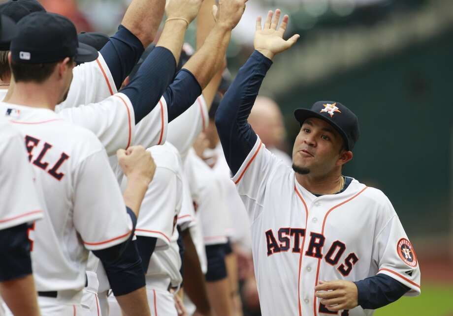 Astros second baseman Jose Altuve greets his teammates during pregame festivities. Photo: Melissa Phillip, Houston Chronicle