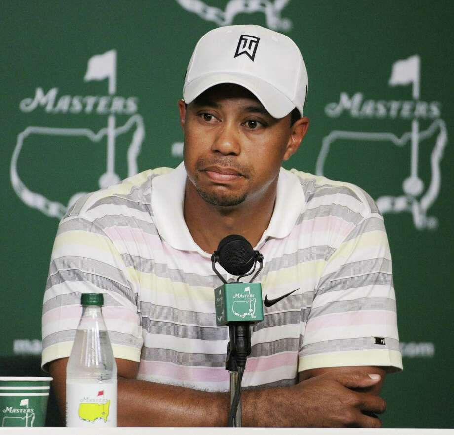 FILE - In this April 5, 2010 file photo, Tiger Woods listens to a question during his news conference at the Masters golf tournament in Augusta, Ga. Woods will miss the Masters for the first time in his career after having surgery on his back. Woods said on his website that he had surgery Monday, March 31, 2014, in Utah for a pinched nerve that had been hurting him for several months. (AP Photo/Harry How, Pool, File) ORG XMIT: NY163 Photo: Harry How / Getty Pool