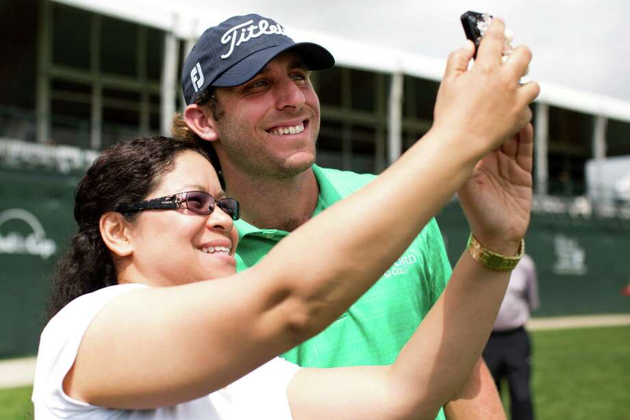 Andrew Loupe frames a moment with fan Sylvia Ireland after finishing his practice round Tuesday. Photo: Marie D. De Jesus, Staff / © 2014 Houston Chronicle