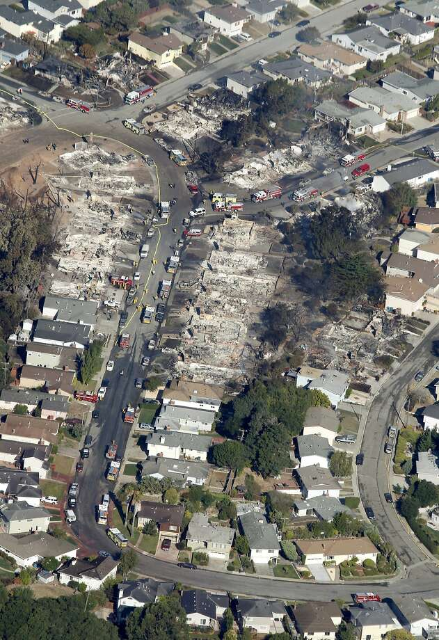 A large section of the Crestmoor neighborhood in San Bruno lies in ruins a day after the PG&E natural gas pipeline explosion that killed eight people and leveled 38 homes on Sept. 9, 2010. Photo: Paul Chinn, The Chronicle