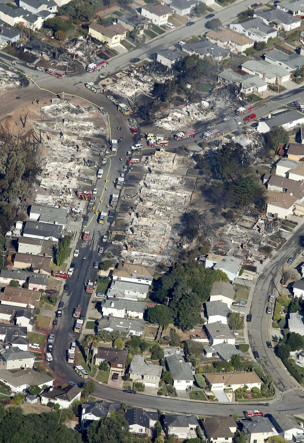 A large section of a neighborhood lies in ruins in San Bruno, Calif. on Friday, Sept. 10, 2010 after a massive natural gas pipeline explosion Thursday night.