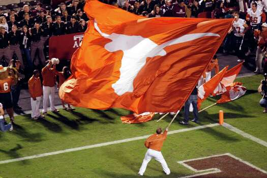 The Longhorns flag waves as the team runs onto the field during the first half of the Texas A&M Aggies vs University of Texas Longhorns rivalry NCAA football game at Kyle Field on Thanksgiving Day, Thursday, November 24, 2011 in College Station, Texas. (Patrick T. Fallon/The Dallas Morning News) Photo: Patrick T. Fallon, Staff Photographer / 10011587B