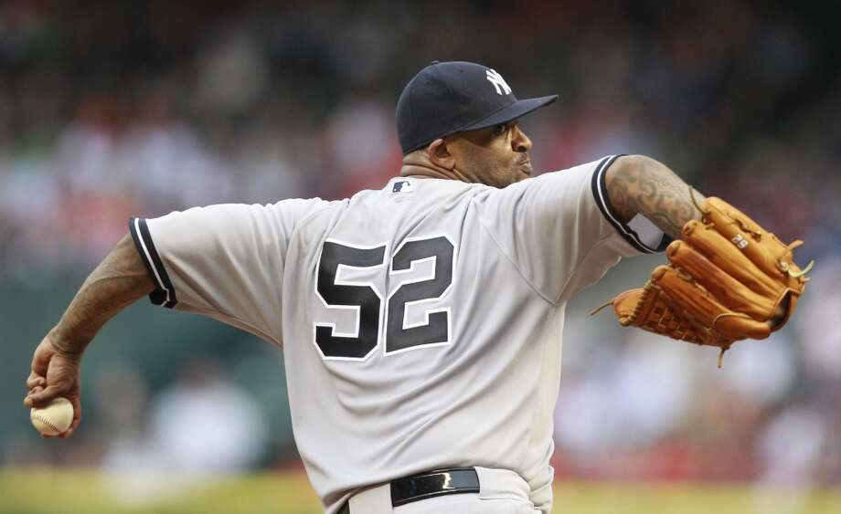 Yankees pitcher CC Sabathia delivers a throw to the Astros Photo: Melissa Phillip, Houston Chronicle