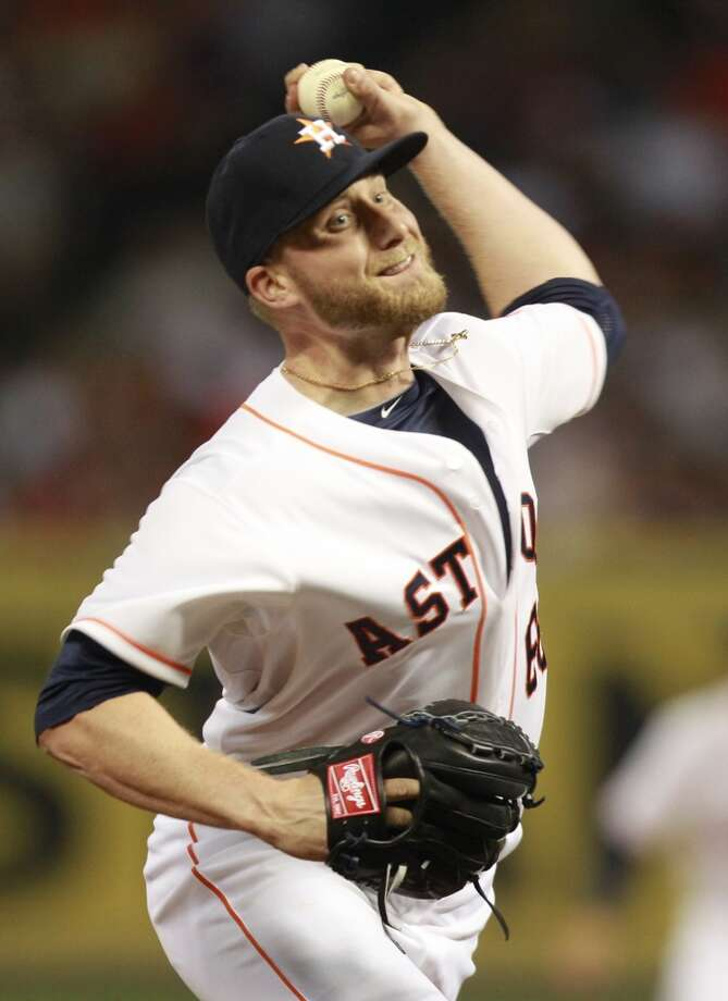 Kevin Chapman of the Astros delivers a throw to the Yankees. Photo: Melissa Phillip, Houston Chronicle
