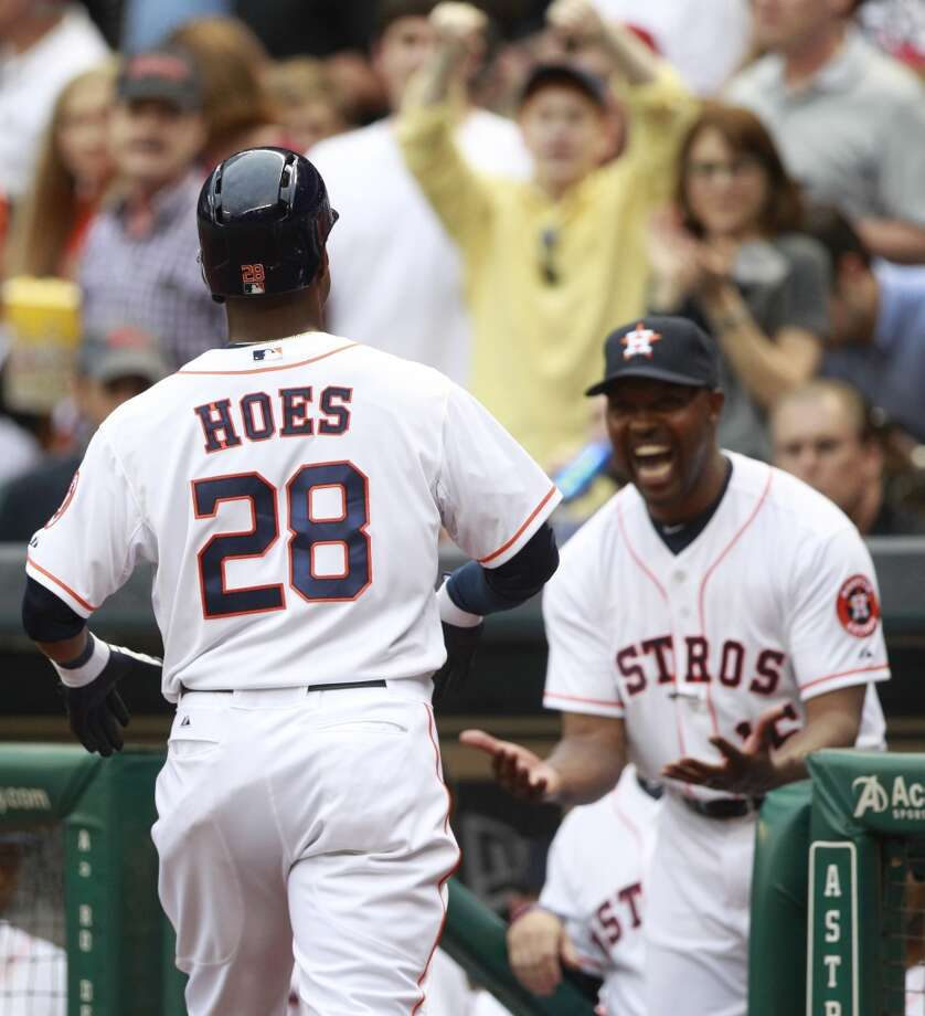 Astros manager Bo Porter celebrates a home run by outfielder L.J. Hoes Photo: Melissa Phillip, Houston Chronicle
