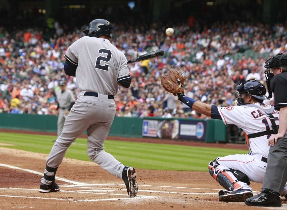 Yankees shortstop Derek Jeter is hit by a pitch during his first at-bat of the season against the Astros. Photo: Melissa Phillip, Houston Chronicle