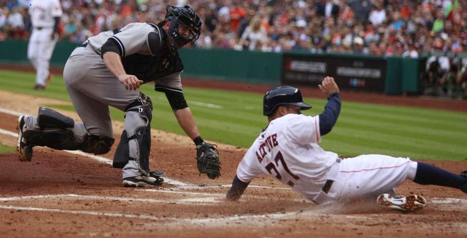 Astros second baseman Jose Altuve scores a run against the Yankees. Photo: Melissa Phillip, Houston Chronicle