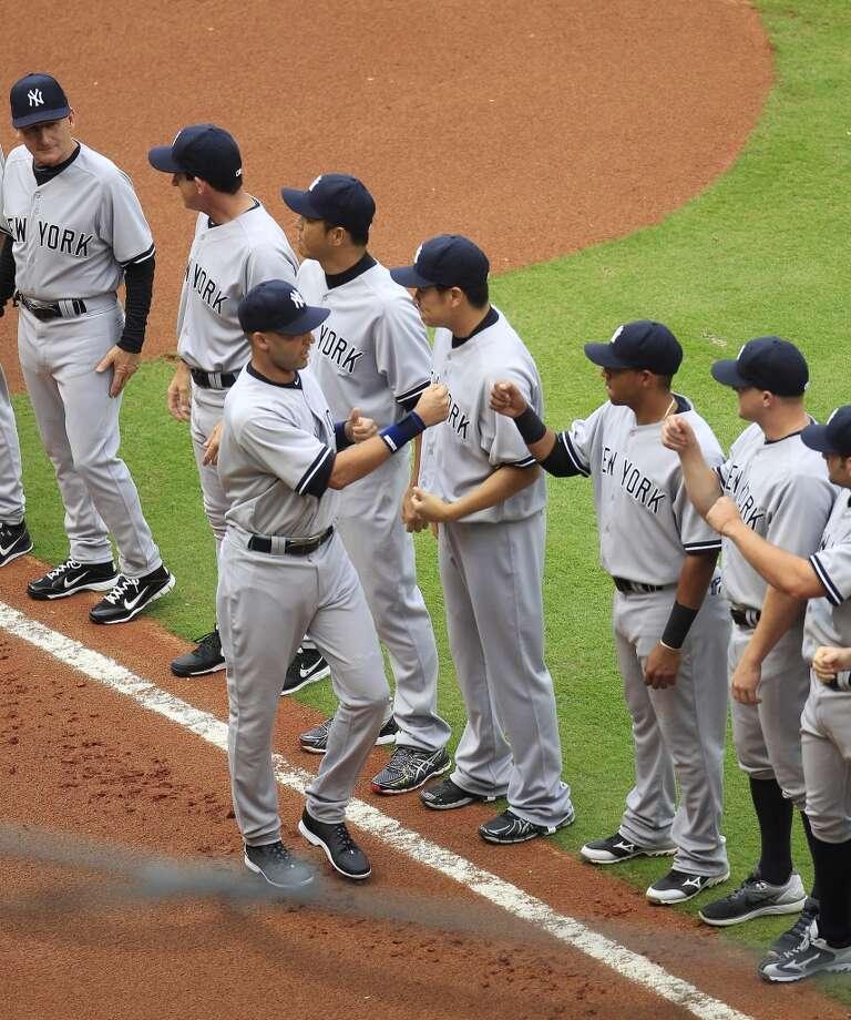 Yankees shortstop Derek Jeter greets his teammates during pregame festivities. Photo: Karen Warren, Houston Chronicle