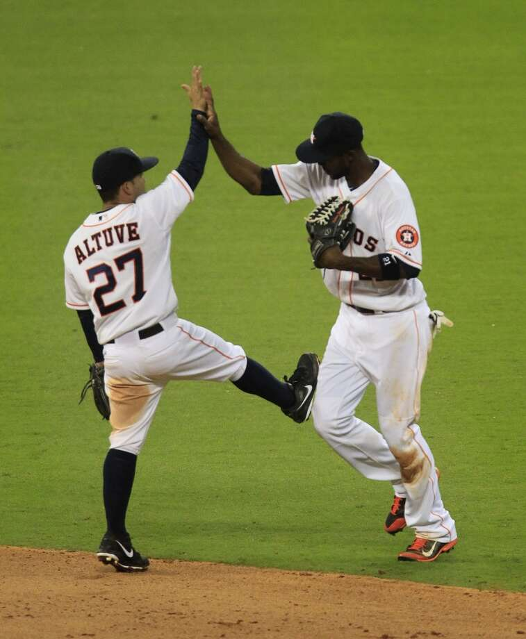 Dexter Fowler and Jose Altuve of the Astros celebrate their win against the Yankees. Photo: Karen Warren, Houston Chronicle