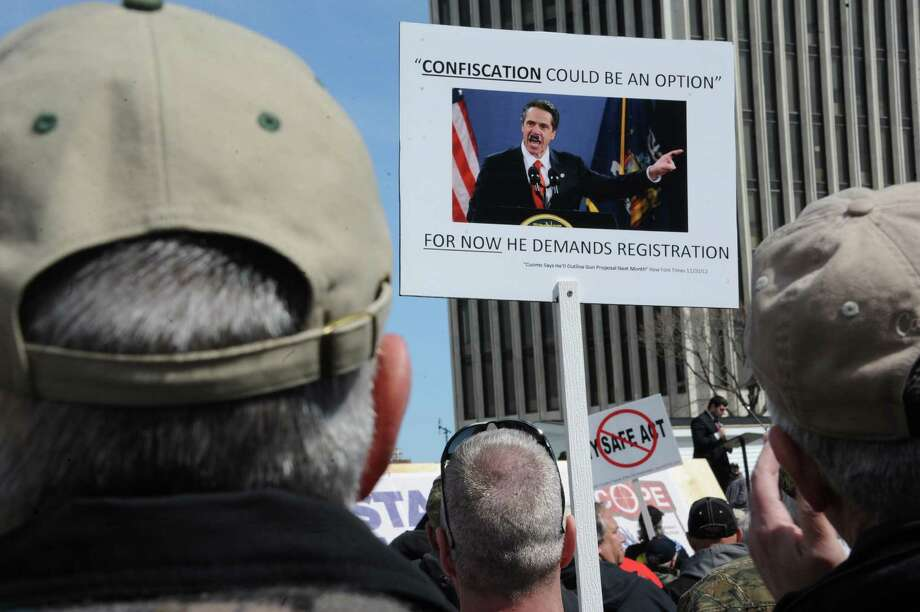 Second Amendment advocates rally against the NY SAFE Act Tuesday, April 1, 2014, at the Empire State Plaza in Albany, N.Y. (Lori Van Buren / Times Union) Photo: Lori Van Buren / 00026330A