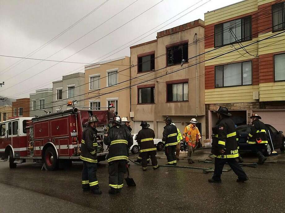 Firefighters at the scene of a two-alarm fire that left one dead, six injured in San Francisco's Sunnydale neighborhood on Tuesday, April 1, 2014. Photo: Vivian Ho, The Chronicle