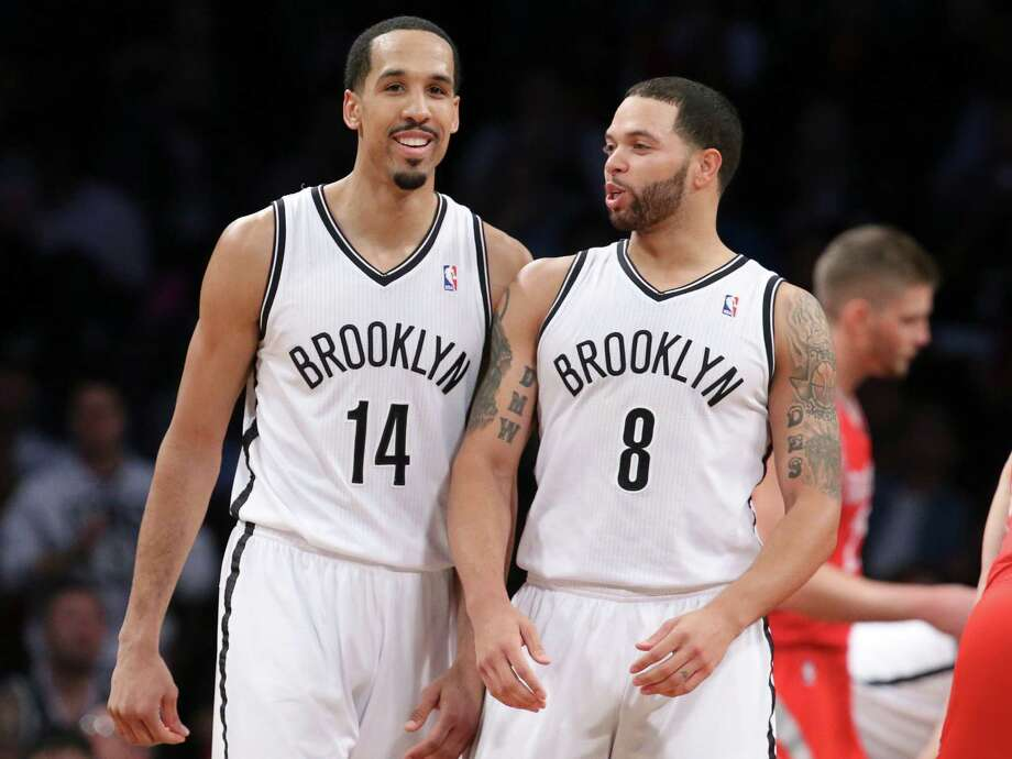 Brooklyn Nets guard Shaun Livingston (14) smiles with guard Deron Williams (8) during the second half of their NBA basketball game against the Houston Rockets at the Barclays Center, Tuesday, April 1, 2014, in New York. The Nets defeated the Rockets, 105-96.  (AP Photo/John Minchillo) ORG XMIT: NYJM119 Photo: John Minchillo / FR170537 AP