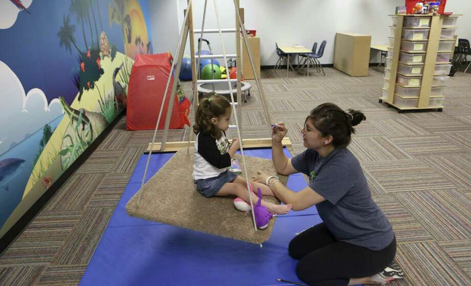 Caroline Buzzard, 3, works with Sarah Quintanilla at UTSA's Teacher Education Autism Model (TEAM) Center which offers behavioral services to autistic children in a teaching lab for special ed teachers. Photo: Helen L. Montoya / San Antonio Express-News / ©2013 San Antonio Express-News