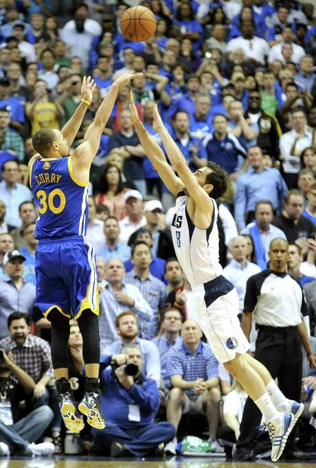 Warriors guard Stephen Curry launches the game-winning shot in overtime over Jose Calderon of the Mavericks. Golden State plays the Spurs tonight. Photo: Matt Strasen / Associated Press / FR170476 AP