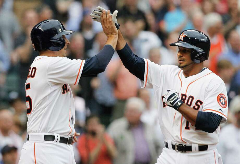 Houston's Jesus Guzman (right) gets a high-five from Jason Castro after hitting a two-run home run during the Astros' four-run first inning against the Yankees at Minute Maid Park. Photo: Bob Levey / Getty Images / 2014 Getty Images