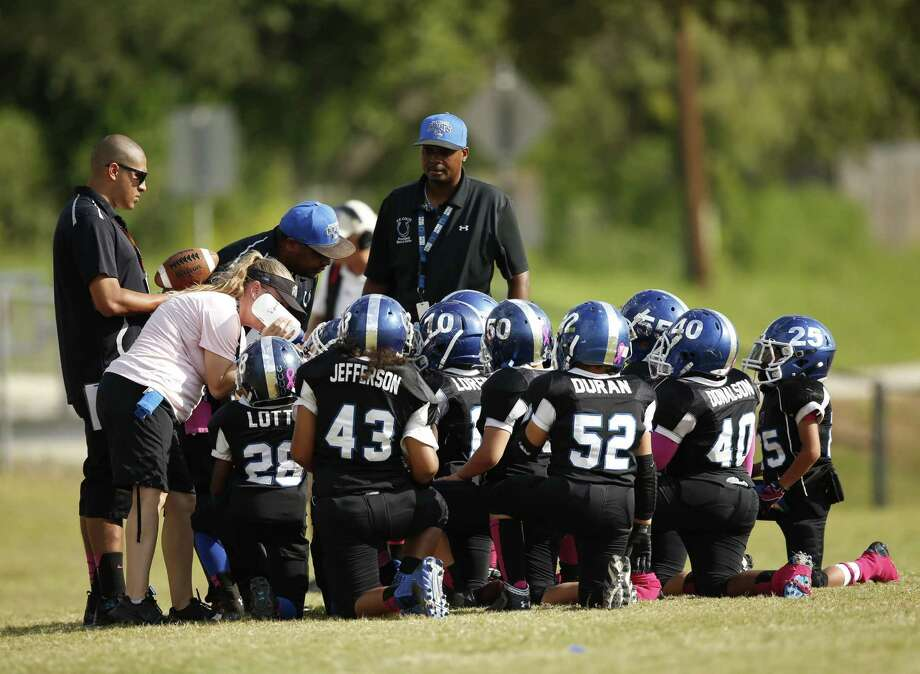 "The Northeast Colts are pictured in a huddle during Season 1 of ""Friday Night Tykes,"" a show on the Esquire Network that documents youth football teams. Photo: NBC Universal Photo / © 2013 Esquire Network"