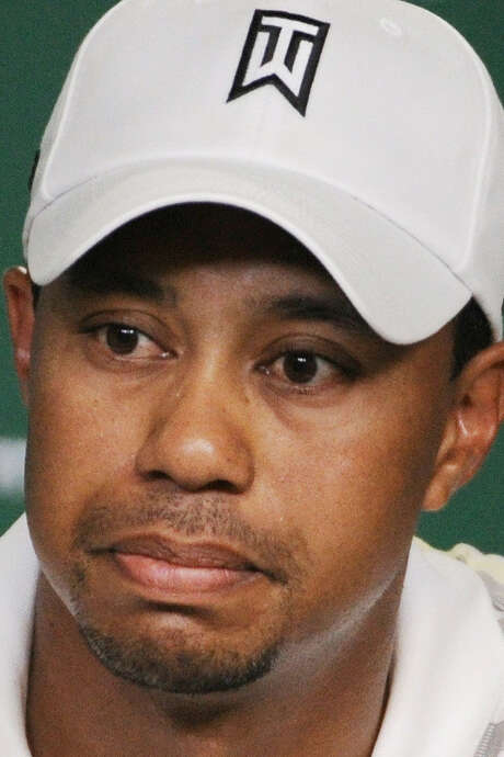 World No. 1 Tiger Woods, winner of four green jackets, will miss the Masters for the first time. / Getty Pool