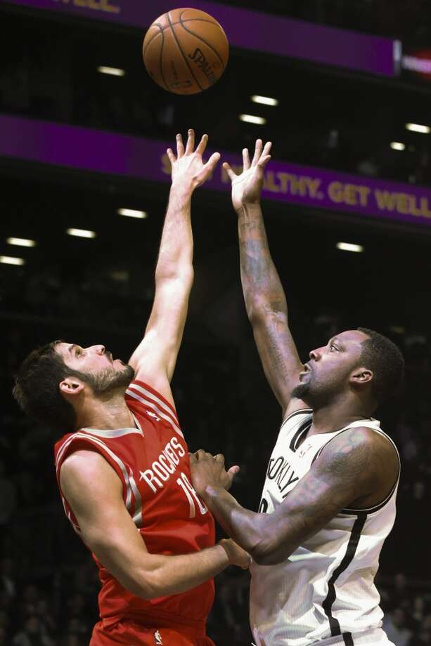 Rockets forward Omri Casspi battles for possession with Andray Blatche of the Nets. Photo: John Minchillo, Associated Press