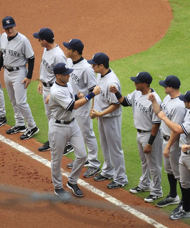 Yankees shortstop Derek Jeter greets his teammates before playing the Astros. Photo: Karen Warren, Houston Chronicle