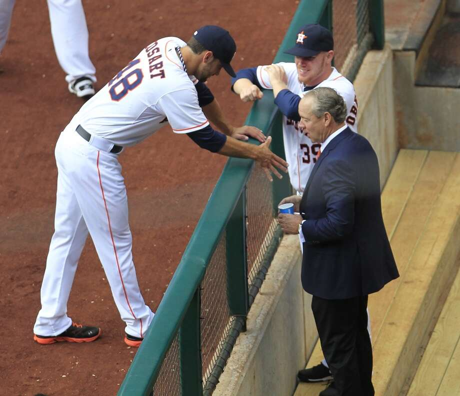 Astros owner Jim Crane speaks with pitchers Jarred Cosart and Brett Oberholtzer. Photo: Karen Warren, Houston Chronicle