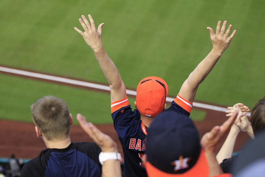 An Astros fan celebrates a run scored against the Yankees. Photo: Karen Warren, Houston Chronicle