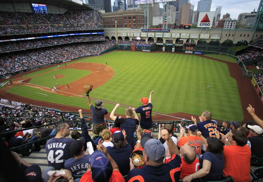 Astros fans celebrates a run scored against the Yankees. Photo: Karen Warren, Houston Chronicle