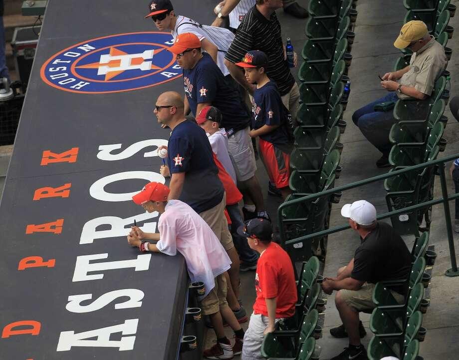 Astros fans await the start of the season opener versus the Yankees. Photo: Karen Warren, Houston Chronicle