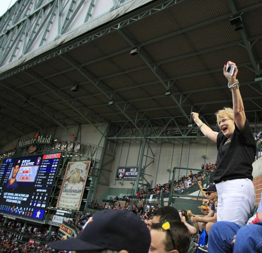 For 40 years Shirle Panetti wanted to attend an Astros game on opening day. She was able to scratch it off her bucket list as the Astros beat the Yankees 6-2. Photo: Karen Warren, Houston Chronicle