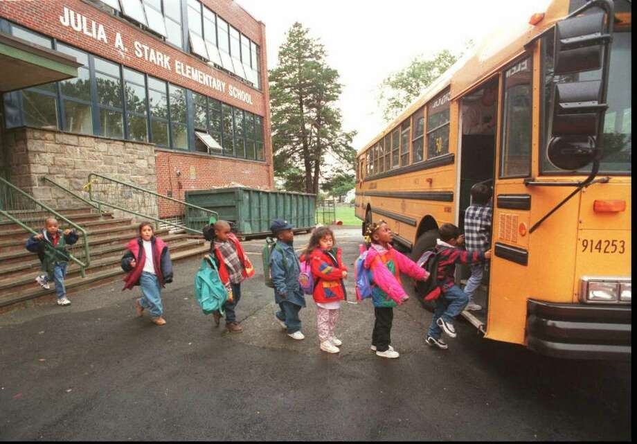Students at Stark Elementary School in Glenbrook board a school bus. Photo: File Photo / Stamford Advocate File Photo
