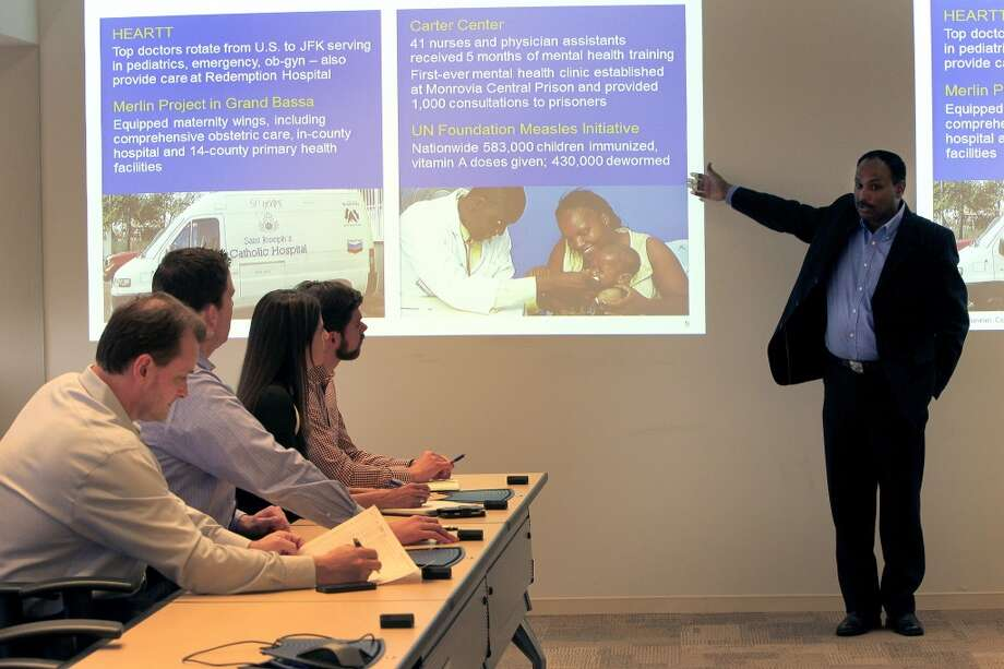Nadeem Anwar, who has managed Chevron's social programs in Liberia and other countries, gives a presentation to the headquarters support team as members discuss progress of community investments in Liberia at Chevron's Houston office. Photo: Karen Warren, Houston Chronicle