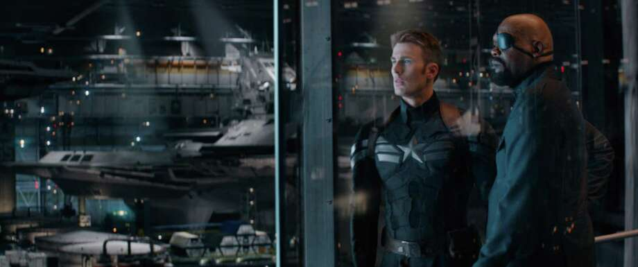 "Chris Evans, left, and Samuel L. Jackson star in ""Marvel's Captain America: The Winter Soldier."" / handout"