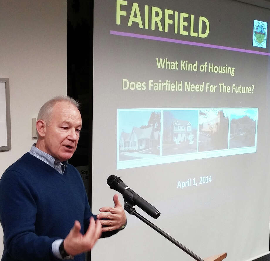 Stephen Grathwohl, chairman of the town's Affordable Housing Committee, addresses a forum on possible updates to the town's affordable housing plan Tuesday night in the Education Center. Photo: Andrew Brophy / Fairfield Citizen