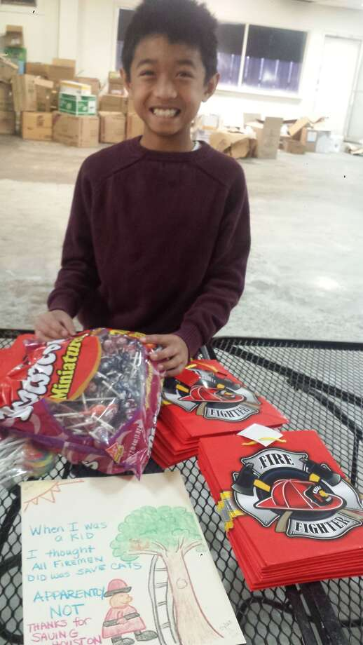 Dylan Carnley, 8, of Houston, with treat bags he helped prepare to thank firefighters for their work. Courtesy photo