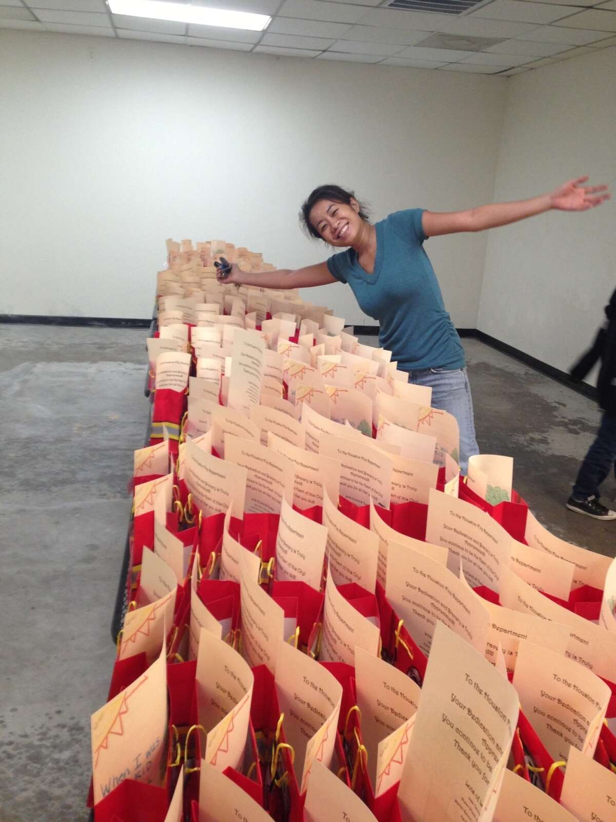 Lisa Carnley, owner of The Cajun Stop restaurant, surveys treat bags for firefighters. Courtesey photo