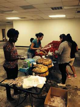 Lisa Carnley, center, and friends put together treat bags for firefighters. Courtesy photo