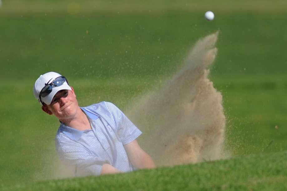 Darien's Christian Ostberg hits out of a bunker during the FCIAC Boys Golf Championship at at Heritage Village Country Club in Southbury, Conn. on Thursday, May 30, 2013.  Greenwich won with a team score of 312 and Darien placed second. Photo: Tyler Sizemore