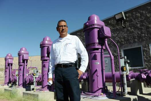 Fred Murillo, Plant Superintendent at the Northwest Wastewater Treatment Plant in El Paso, TX., talks Tuesday, September 5th,  about the reclaimed water the plant produces and where the water is used throughout the El Paso area. Much of the water treated by the plant gets put into the Rio Grande River, but some of water heads through these purple pipes and is used by local golf courses, high schools, and businesses for irrigation and other non potable uses. Photo: DAN DALSTRA, For The Houston Chronicle / Freelance