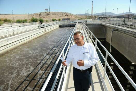 Fred Murillo, Plant Superintendent for the Northwest Wastewater Treatment Plant in El Paso, TX., points out wastewater being treated by the plant on its way through the plant Tuesday, September 5th. The plant takes a portion of the water  it treats and uses it for irrigating local golf courses and high schools as a way for the city to save on water usage. Local companies can also buy the non-drinkable water for similar uses. Photo: DAN DALSTRA, For The Houston Chronicle / Freelance