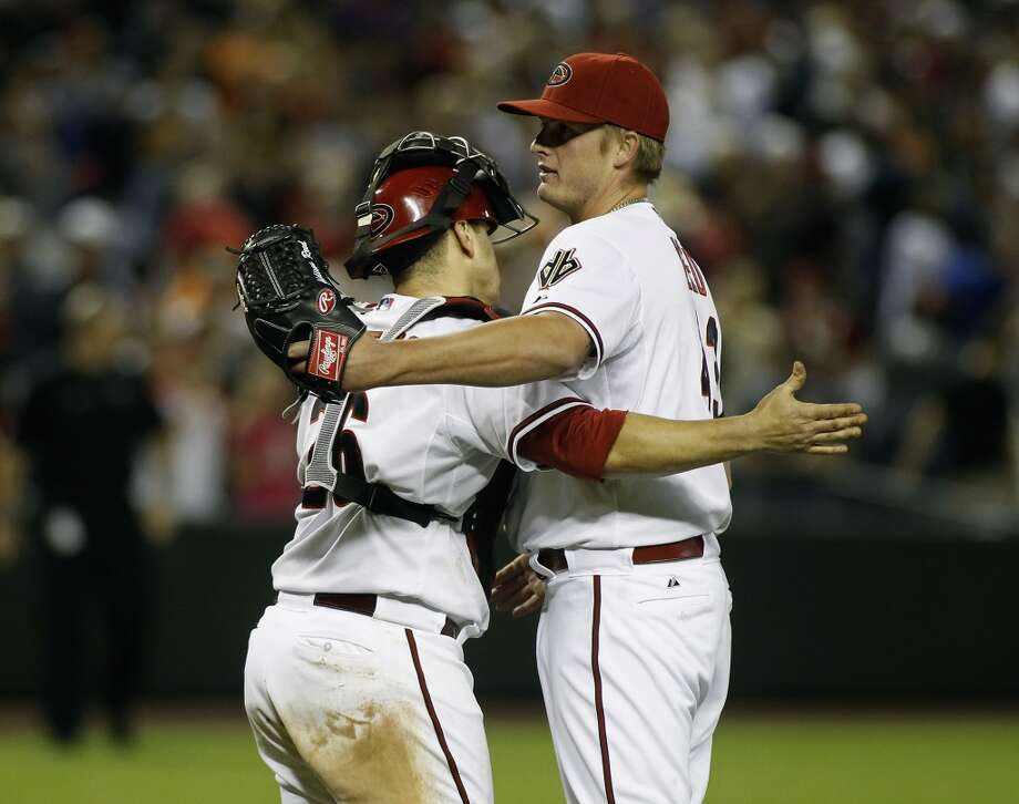 Pitcher Addison Reed #43 of the Arizona Diamondbacks is congratulated by catcher Miguel Montero #26 after pitching the ninth inning for a save against the San Francisco Giants during a MLB game at Chase Field on April 1, 2014 in Phoenix, Arizona.  The Diamondbacks defeated the Giants 5-4. Photo: Ralph Freso, Getty Images