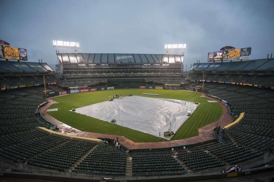 General view of the O.co Coliseum with the tarp on the field before the postponed game between the Oakland Athletics and the Cleveland Indians. Photo: Ed Szczepanski, Reuters