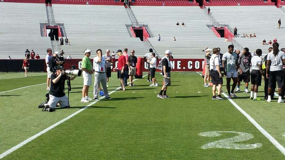 South Carolina head coach Steve Spurrier (in green) looks on during the pro day. Photo: Brian T. Smith, Houston Chronicle