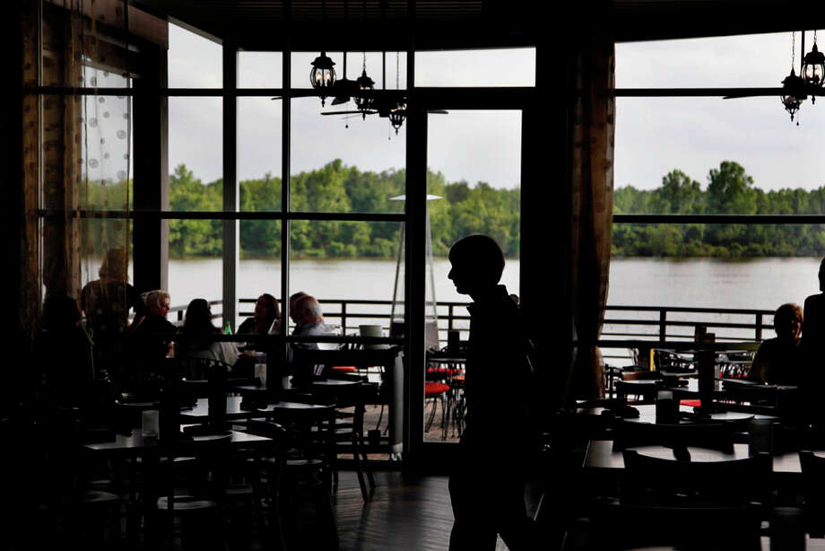 Large windows allow customers eating inside to view Lake Houston while they eat at The Tasting Room on Wednesday, April 4, 2012, in Kingwood. ( Mayra Beltran / Houston Chronicle ) Photo: Mayra Beltran, Houston Chronicle / © 2012 Houston Chronicle
